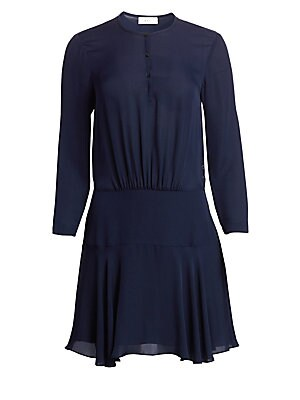 "Image of Chic silk dress with button-up roundneck collar, ruched drop waist and floaty mini skirt. Roundneck Long sleeves Three-button closure at front Dropped ruched waist Silk Dry clean Imported SIZE & FIT Mini dress About 37"" from shoulder to hem Model shown is"