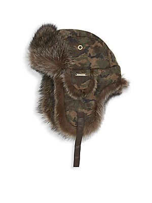 """Image of A winter essential, this camo melton-flap hat is trimmed with warm fur. Ear flaps Wool melton/polyester/viscose Fur type: Dyed raccoon Fur origin: Canada Dry clean by fur specialist Made in Canada SIZE 11.5""""W x 12.5""""H x 5""""D. Men Accessories - Cold Weather"""