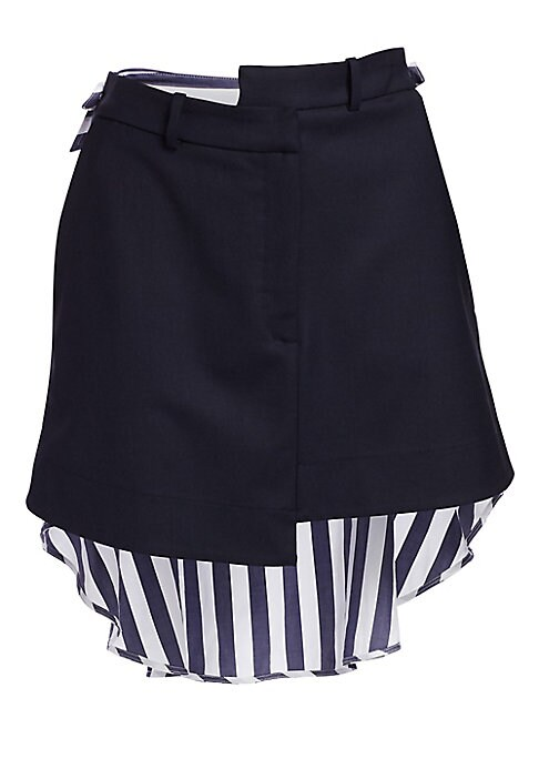 Image of From the Saks It List: The Mini Skirt. On-trend and ready-to-wear, this skirt boasts asymmetric details with a modern mixed media design. Cut from stretch wool-blend fabric for casual comfort. Belt loops. Zip fly with hook closure. Side slash pockets. Sel