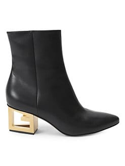 f50264afa846 Product image. QUICK VIEW. Givenchy. Triangle Logo Heel Ankle Booties