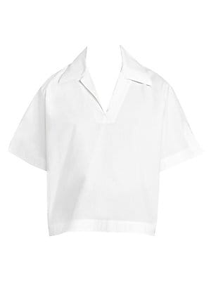 Image of A crisp cotton poplin blouse in a structured boxy silhouette. Menswear-inspired tailoring and notch details add elegance to this piece. Point collar V-neck Short sleeves Pullover style Notch cuffs Side slits Back yoke Cotton Dry clean Imported SIZE & FIT