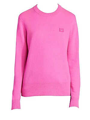 Image of A bubblegum pink hue lends this wool crewneck sweater a lively air. A tonal logo patch at the chest acts as a simple label signifier. Crewneck Long sleeves Ribbed cuffs and hems Pullover style Dropped shoulders Wool Dry clean Imported SIZE & FIT About 25""