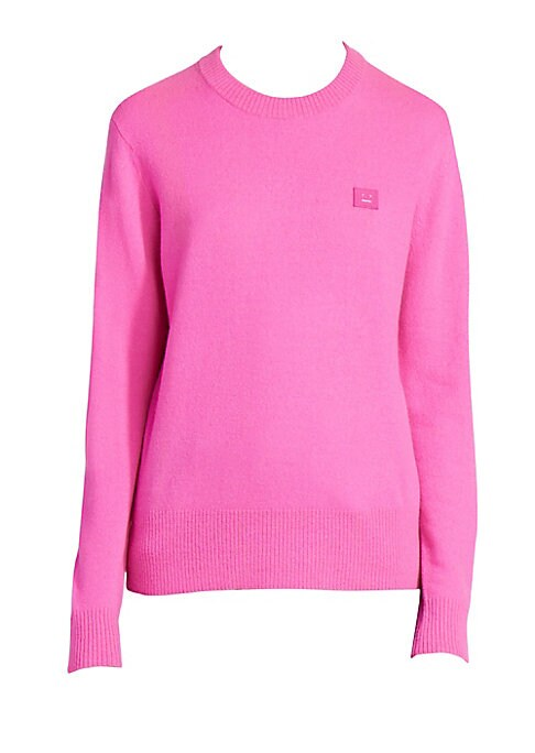 Image of A bubblegum pink hue lends this wool crewneck sweater a lively air. A tonal logo patch at the chest acts as a simple label signifier. Crewneck. Long sleeves. Ribbed cuffs and hems. Pullover style. Dropped shoulders. Wool. Dry clean. Imported. SIZE & FIT.