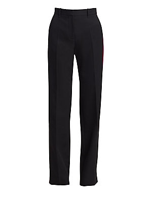 Image of A modern take on the timeless tuxedo pant, these tailored silk trousers turn the side to reveal a chic baby pink side stripe. Their elongated leg and sartorial pleated finish create a modern streamlined silhouette. Belt loops Zip fly Side slip pockets Bac