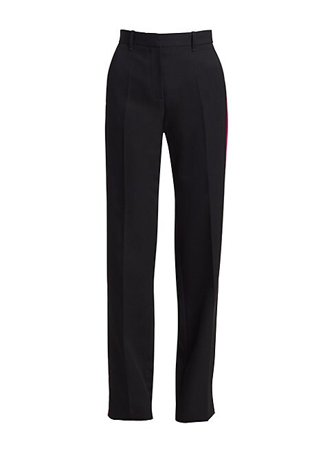 Image of A modern take on the timeless tuxedo pant, these tailored silk trousers turn the side to reveal a chic baby pink side stripe. Their elongated leg and sartorial pleated finish create a modern streamlined silhouette. Belt loops. Zip fly. Side slip pockets.