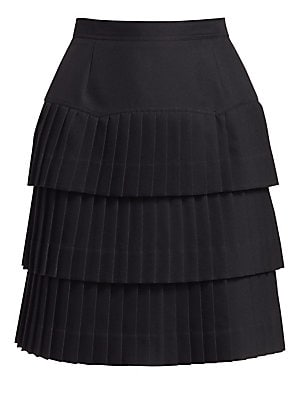 Image of This little black skirt is taken from basic to playful with the addition of three tiers of ruffles. Sharp pleats imbue the skirt with extra movement. Banded waist Concealed back zip with hook closure Pleated hems Polyester Dry clean Made in Italy SIZE & F