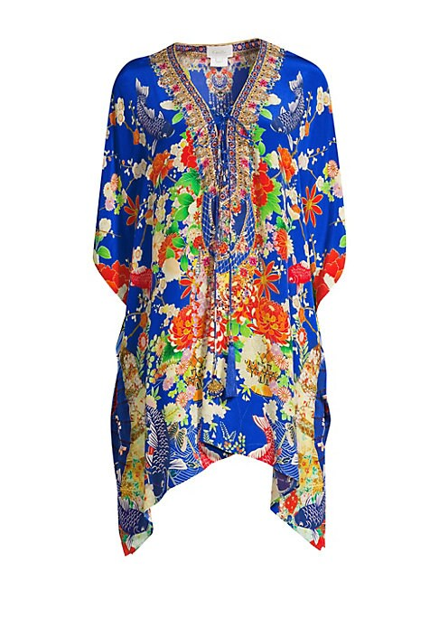 """Image of Bold floral print silk caftan in a floaty relaxed silhouette.V-neck. Elbow-length bell sleeves. Lace-up neckline. Asymmetric hem. Silk. Dry clean. Imported. SIZE & FIT. About 36"""" from shoulder to hem."""