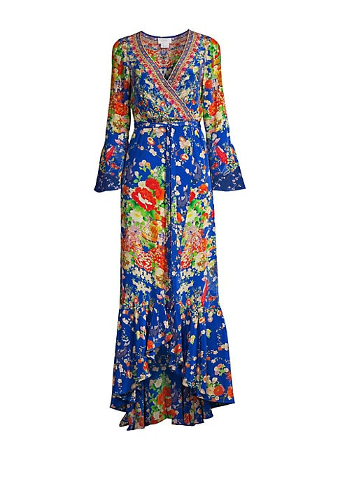 """Image of Boho floral print accentuates opulent bell sleeves and ruffles. Surplice V-neck. Long bell sleeves. Self-tie waist. Ruffled hem. Silk. Dry clean. Imported. SIZE & FIT.A-line wrap silhouette. About 58"""" from shoulder to hem. Model shown is 5'10"""" (177cm) wea"""