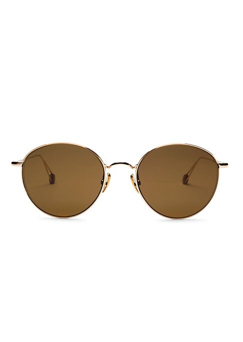 Image of Sleek metal frames highlight these round lenses. Hydrophobic lenses enhance clarity while protecting against water and smudging.100% UV protection. Palladium electroplated gold. Made in France. SIZE. Lens width, 53mm. Bridge width, 20mm. Temple length, 14