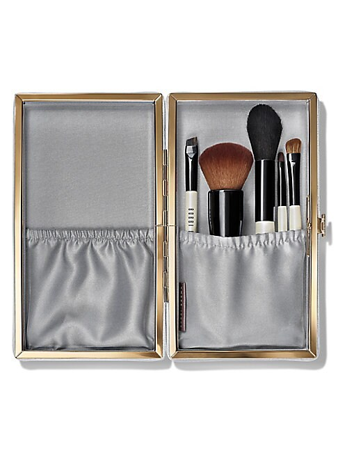 Image of $203 VALUE.A five-piece set of our bestselling makeup brushes for face, eyes and brows in mini sizes with full-sized brush heads, all stored in a sleek silver case. Designed for flawless application on the go, these travel-size tools are perfect for stowi