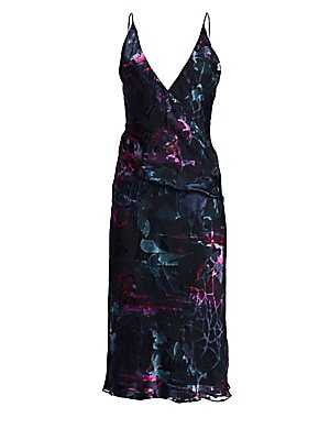Image of A modernly sexy wrap dress cut to just below the knee with a plunging V-neck construction in a fluid silhouette. An abstract melted floral print on a base of double georgette and silk crepe adds a romantic feel. V-neck Spaghetti straps Concealed back zip