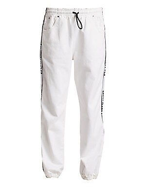 """Image of Casual cotton joggers with tapered leg boast contrast logo details. Elasticized drawstring waist Front pockets Back welt pocket Elasticized cuffs Side logo piping Cotton Dry clean Imported SIZE & FIT Tapered leg silhouette Rise, about 10"""" Inseam, about 15"""