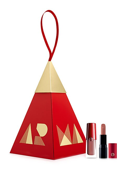 Image of WHAT IT IS.A festive holiday ornament with a duo of Lip Magnet and Rouge D' Armani Matte mini, in rosy nude shades. Made in France. TWO-PIECE SET INCLUDES. Lip Magnet Liquid Lipstick in shade 508 - Androgini (Nude Rose), 0.13 oz. Rouge D'Armani Matte Lips