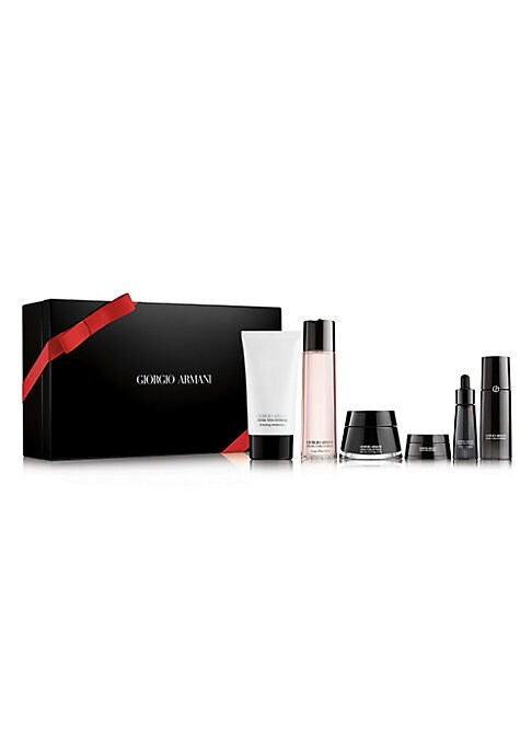 Image of WHAT IT IS.A luxurious Giorgio Armani black set box featuring a collection of 6 full sized Crema Nera skin care products, designed to rejuvenate skin and reverse the effects of aging using Armani's exclusive Reviscentalis Complex along with pantelleria mi
