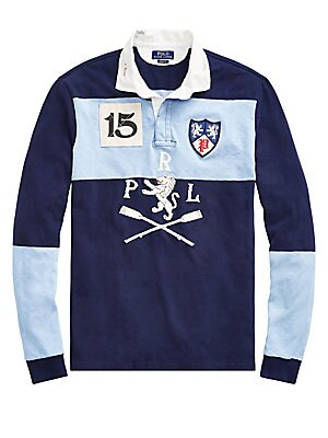 Image of An essential part of prep-school style, the classic rugby shirt gets a Polo upgrade with Polo Ralph Lauren's take on old-world club emblems. Polo Ralph Lauren's roomiest silhouette, cut for a lower armhole and a fuller sleeve. Spread collar Long sleeves C