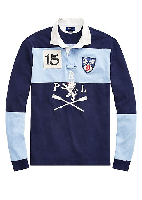 Image of An essential part of prep-school style, the classic rugby shirt gets a Polo upgrade with Polo Ralph Lauren's take on old-world club emblems. Polo Ralph Lauren's roomiest silhouette, cut for a lower armhole and a fuller sleeve. Spread collar. Long sleeves.