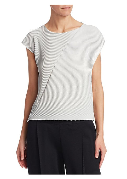"""Image of A silky pleated-allover top with a simplistic yet stylish asymmetric design. Pairs easily with trousers or skirts for a sophisticated look. Scoopneck. Cap sleeves. Pullover style. Lined. Polyester. Dry clean. Made in Japan. SIZE & FIT. About 22"""" from shou"""