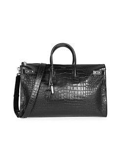 d5ae96114a Saint Laurent. Croc-Embossed Leather Duffle Bag