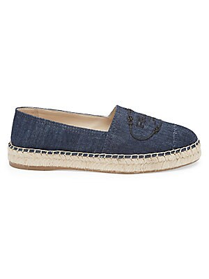 Image of Covetable denim espadrilles with embroidered Prada logo and jute trim. Cotton upper Round toe Slip-on style Leather lining Jute midsole Synthetic sole Imported. Women's Shoes - Prada Womens Shoes. Prada. Color: Blue. Size: 37 (7).