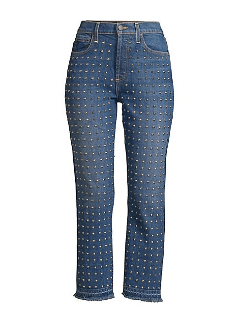 """Image of From the Saks It List: Luxe Denim. Cropped jeans embellished with allover studs and finished with frayed hems. Five-pocket style. Button closure. Zip fly. Cotton/elastane. Machine wash. Made in USA. SIZE & FIT. Cropped slim fit. Rise, 11"""".Inseam, 26"""".Leg"""