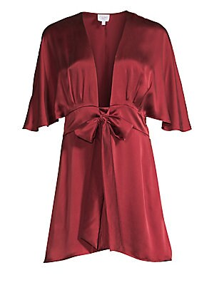 """Image of Constructed out of pure silk, this gorgeous mini dress flaunts a plunging neckline finished with a bow detail. Deep V-neck Flutter sleeves Concealed side zip closure with self-tie at waist Silk Hand wash Imported SIZE & FIT About 33"""" from shoulder to hem"""
