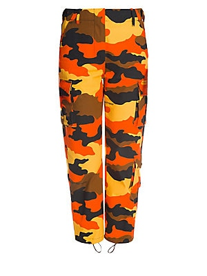 Image of These classic cargo pants get a punchy update with their bright camo print. Their cropped length and lightweight cotton construction make them an easy-to-wear pant that makes a statement with every step. Belt loops Zip fly Side seam pockets Front flap car