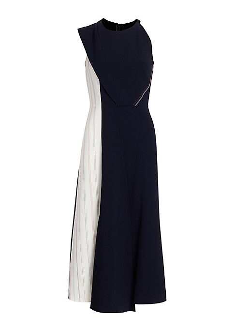 Image of Asymmetry and overlapping panels are hallmarks of the designer and both are showcased beautifully in this midi-length dress. A deep navy blue body is broken up with a cream-hued panel stitched with multicolored stripes, resulting in a tailored piece with
