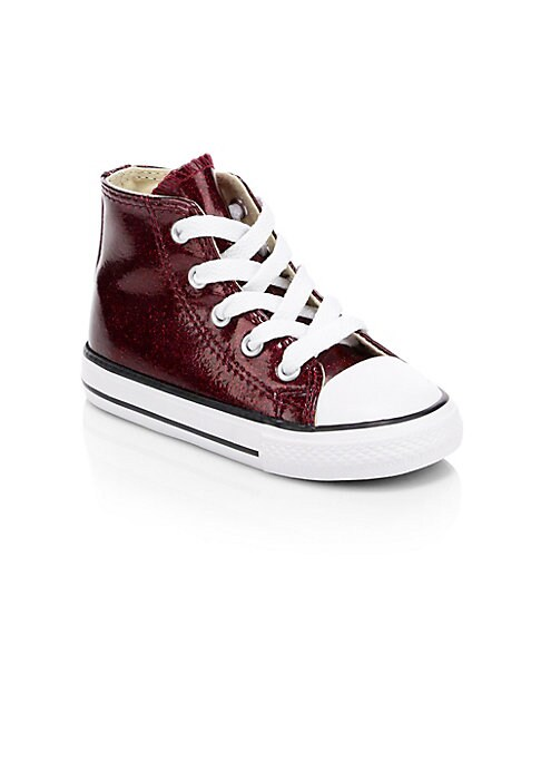 Image of Classic converse sneakers made for kids complete with a cool glittered upper. Synthetic upper. Textile lining. Rubber sole. Imported.