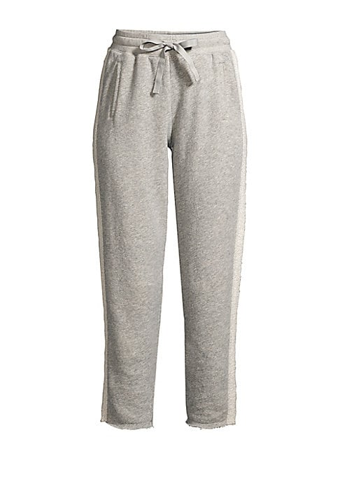 """Image of A cropped leg, raw hems and side stripe detailing lend these joggers plenty of style. Elasticized drawstring waistband. Pull-on style. Waist welt pockets. Raw hems. Cotton. Machine wash. Imported. SIZE & FIT. Rise, about 12"""".Inseam, about 28"""".Leg opening,"""