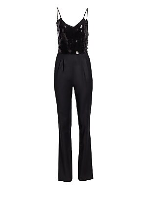 Image of Dazzling sequins lend a striking sheen to this svelte jumpsuit. Flaunting pockets and a plunging neckline, this piece embodies a refined sense of sensuality. Deep V-neck Spaghetti straps Sleeveless Concealed side zip Side slash pockets Sequin finish Polye
