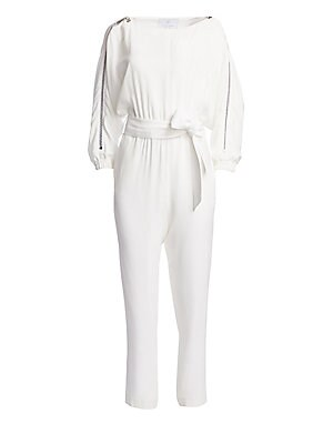 Image of From the Saks It List: The Jumpsuit Luxe crepe satin romper boasts on-trend bateau neckline and eye-catching zippers at sleeves. Made in France, this statement piece also features a wide sash belt with a slim straight-leg silhouette. Bateau neck Long slee