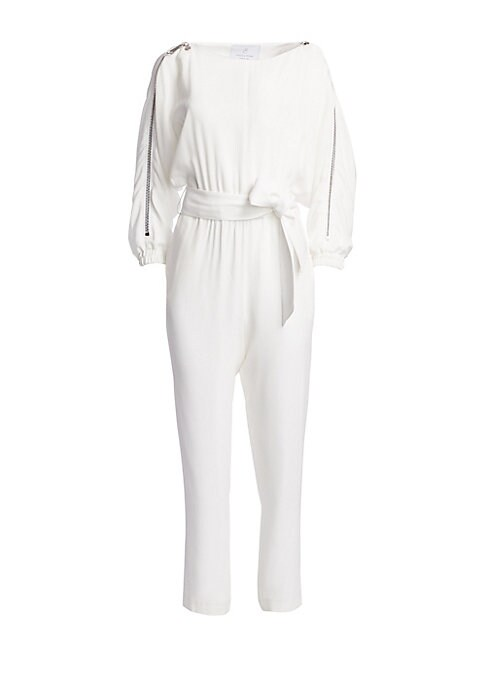 Image of From the Saks It List: The Jumpsuit. Luxe crepe satin romper boasts on-trend bateau neckline and eye-catching zippers at sleeves. Made in France, this statement piece also features a wide sash belt with a slim straight-leg silhouette. Bateau neck. Long sl