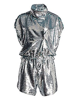 Image of From the Saks It List: The Jumpsuit Shine in this dazzling romper with allover sequins. Made in France, this statement piece features eye-catching snaps with dramatic high neck and figure-flattering cinched waist. Stand collar Short sleeves Snap button fr