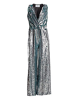 Image of From the Saks It List: The Jumpsuit Shine in this dazzling romper with allover sequins. Made in France, this statement piece features an eye-catching V-neck design with figure-flattering wide leg silhouette. Spliced V-neck Sleeveless Elasticized waist Pol