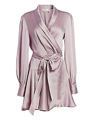 """Image of A silk construction lends a carefree elegance to this wrap dress finished with goldtone buttons at the cuff. Shawl collar Long sleeves Buttoned cuffs Self-tie at waist Ruffle hem Silk Dry clean Imported SIZE & FIT About 32.25"""" from shoulder to hem Model s"""
