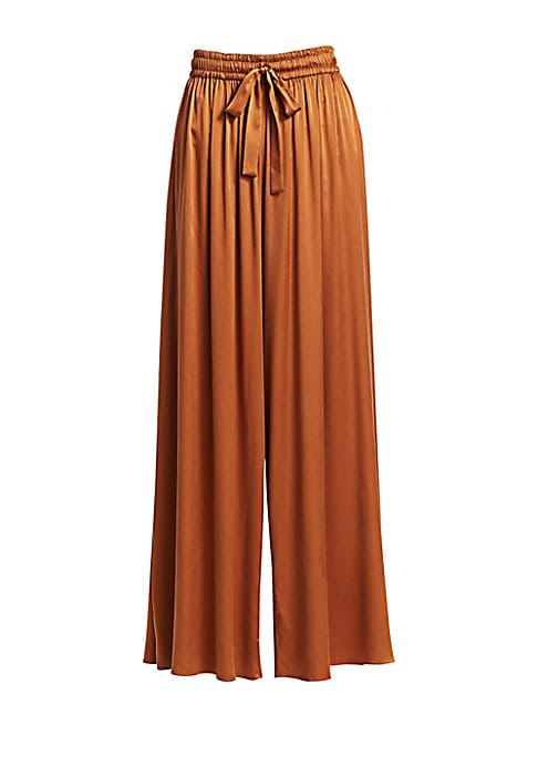 "Image of Breezy wide leg pants are designed with a glamorous sweeping silhouette in fluid silk. Elasticized drawstring waist. Side slip pockets. Pull-on style. Silk. Dry clean. Made in Italy. SIZE & FIT. Wide leg. Inseam, about 32"".Model shown is 5'10"" (177cm) wea"