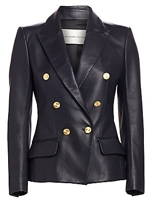 Image of A strong shoulder is mirrored by the sharp peak lapels on this leather blazer. Glistening goldtone buttons add a hit of glamour to the jacket. Peak lapels Long sleeves Buttoned cuffs Concealed back zip closure Waist flap pockets Back vent Lined Leather Dr