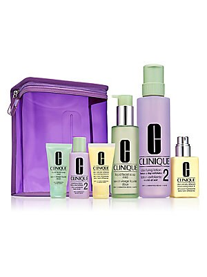 Image of $97 VALUE WHAT IT IS Custom-fit, 3-Step skin care kit for Very Dry to Dry Combination Skin. Full sizes and minis plus a travel-ready bag. A $97 value. Non-drying Liquid Facial Soap cleans gently, rinses easily. Clarifying Lotion Twice A Day Exfoliator swe