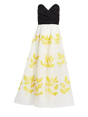 Image of A palette of black, white and marigold is unexpected in evening wear, but this gown proves it's a winning combo. Delicate leaf-shaped embellishment enhances the full-skirted silhouette of the frock. Strapless sweetheart neckline Concealed back zip closure