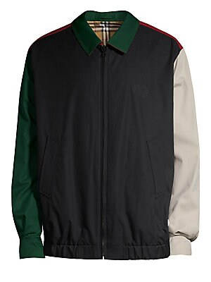 Image of A Harrington jacket in color-block tropical gabardine, with an embroidered crest and Vintage check reverse. Spread collar Long sleeves Banded cuffs Zip front Waist slip pockets Elasticized hem Jacket is check on reverse side Cotton Dry clean Made in Italy