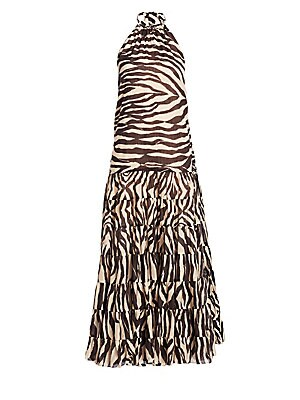 """Image of Airy zebra printed maxi dress in halter neck style. Halter neckline with tie closure Sleeveless Concealed back zip closure Cotton/linen Hand wash Imported SIZE & FIT Loose silhouette About 40"""" from shoulder to hem Model shown is 5'10 (177cm) wearing US si"""