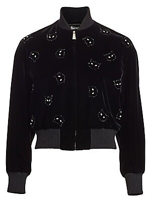Image of An update on the classic bomber, this soft velvet iteration flaunts whimsical allover cat patches. Its cropped silhouette is ideal for teaming with high-rise skirts or jeans for a playful off-duty look. Baseball collar Long sleeves Front zip close Rib-kni
