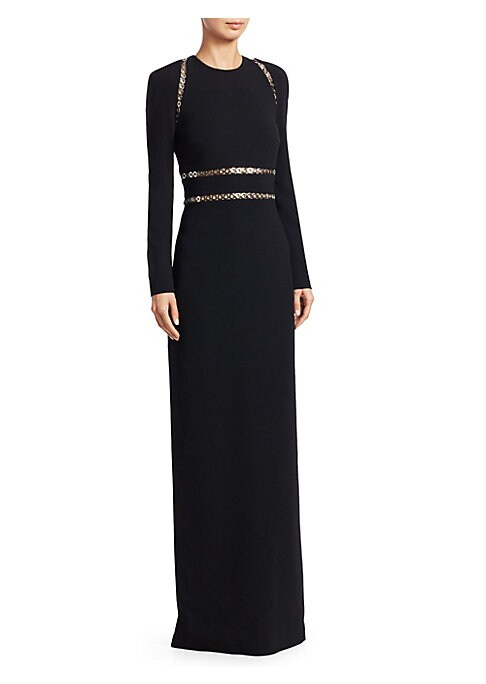Image of Alexander Wang's masterful minimalism is perfectly executed in this long sleeve column dress. Shiny grommets add an edgy sensual look while showing a glimpse of skin. Roundneck. Long sleeves. Concealed back zip closure. Grommet trim. Back hem slit. Stretc