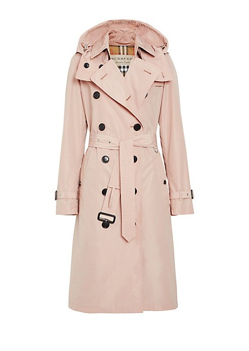 Image of Burberry's classic fit trench is seen here reimagined with a streamlined silhouette and modern oversized proportions. Its sleek buttoned front and structured hood make it a versatile outerwear piece that is finished with the brand's signature check lining