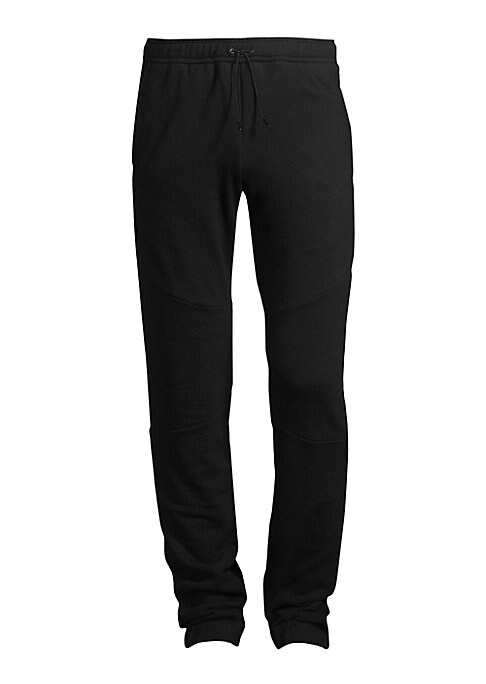 Image of These pants marry a jogger front with a jean back for a unique silhouette. Elasticized drawstring waistband. Pull-on style. Side slash pockets. Back patch pockets. Lined. Front: Elastane/cotton. Back: Cotton. Dry clean. Made in Italy. SIZE & FIT. Rise, ab