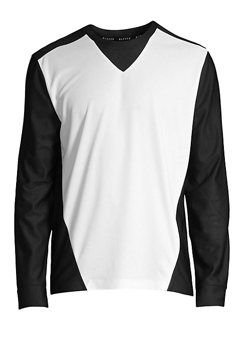"Image of Long sleeve monochrome tee in waterproof textures. Crewneck. Long sleeves. Pullover style. Polyester. Machine wash. Imported. SIZE & FIT. About 28"" from shoulder to hem."
