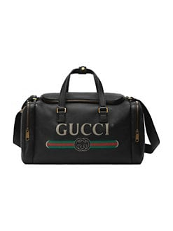 c864413f9e3a QUICK VIEW. Gucci. Gucci Print Leather Carry-On Duffle