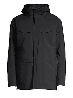 """Image of Athleisure jacket is crafted with a minimalist design. Attached hood Stand collar Long sleeves Zip front Chest and waist flap pockets Fully lined Nylon/polyester Machine wash Made in Canada SIZE & FIT About 29"""" from shoulder to hem. Men Adv Contemp - Cont"""