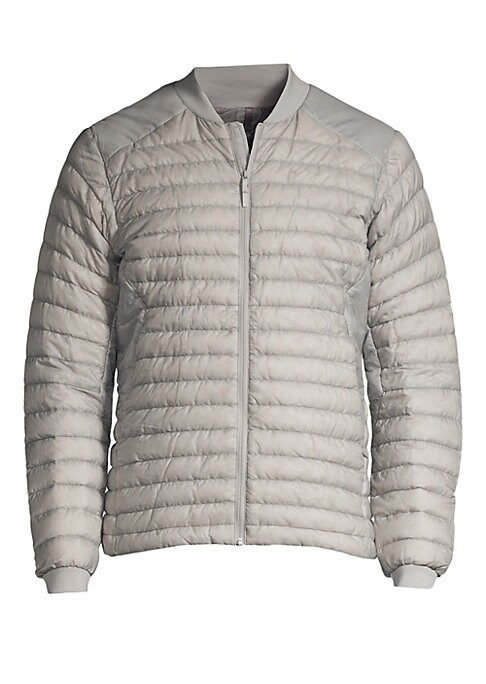 Image of Lightweight down-filled puffer jacket - ideal for layering - constructed from water-and-wind-resistant fabric. Baseball collar. Long sleeves. Front zip closure. Waist zip pockets. Nylon. Fill: Goose down/goose feather. Machine wash. Imported. SIZE & FIT.