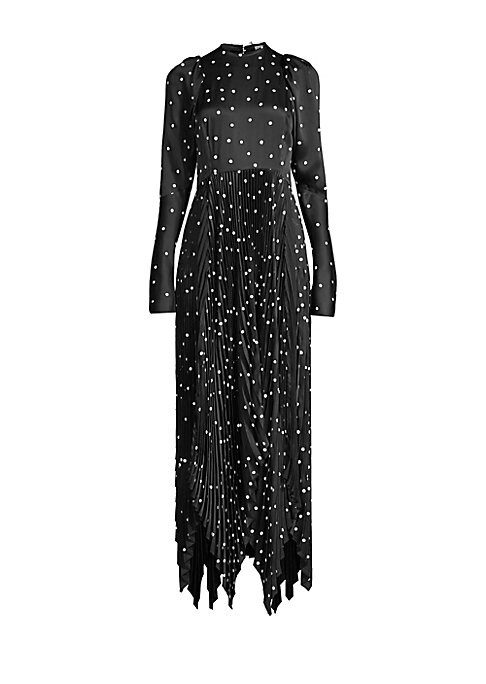 Image of From the Saks It List: The Maxi Dress. There's an art to party dresses, and Khaite's Catherine Holstein has nailed it here. Flocked velvet polka dots stand out against a black backdrop, with soft puff sleeves matched with a pleated, handkerchief hem skirt